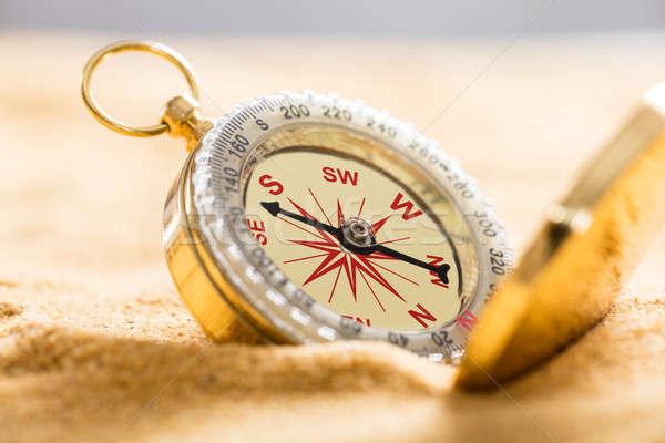 Kompass Sandstrand Navigations- Strand tropischen Stock foto © AndreyPopov