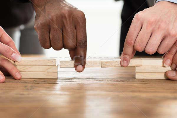 Teamwork Or Building Bridges Concept Stock photo © AndreyPopov