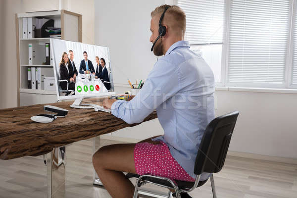 Businessman Attending Video Conference On Computer Stock photo © AndreyPopov