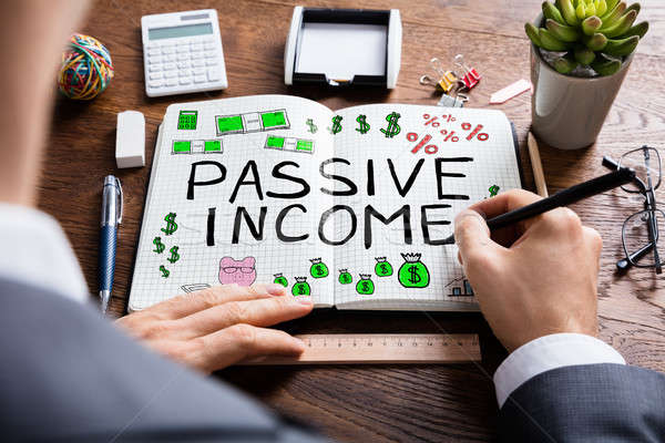 Man Drawing Passive Income Concept Stock photo © AndreyPopov