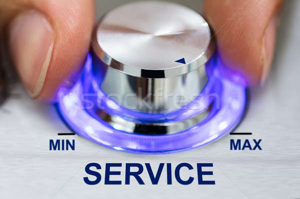 Hand Turning Illuminated Knob By Service Text Stock photo © AndreyPopov