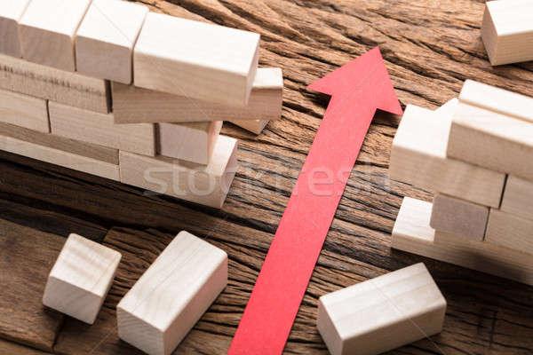 красный бумаги стрелка блоки деревянный стол Сток-фото © AndreyPopov