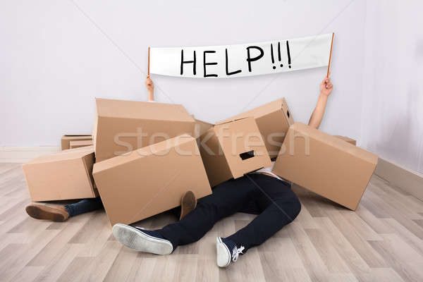 Couple Lying Under The Cardboard Boxes Showing White Flag Stock photo © AndreyPopov