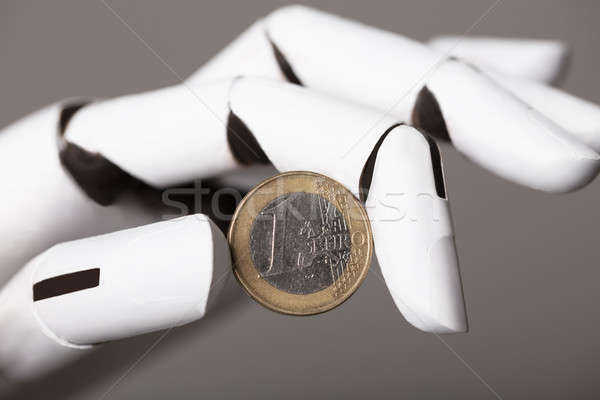 Robotikus kéz mutat egy Euro érme Stock fotó © AndreyPopov
