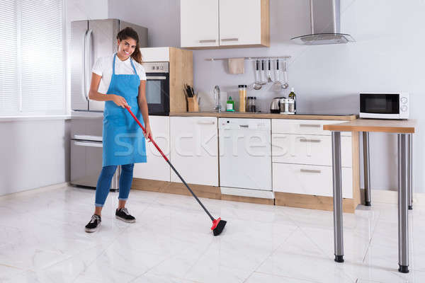 Housemaid Cleaning Floor With Broom Stock photo © AndreyPopov