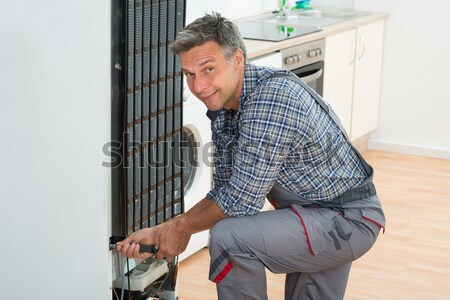 Male Worker Applying Silicone Sealant Stock photo © AndreyPopov