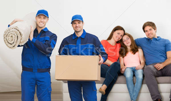Two Mover Men Carrying Cardboard Box And Carpet Stock photo © AndreyPopov