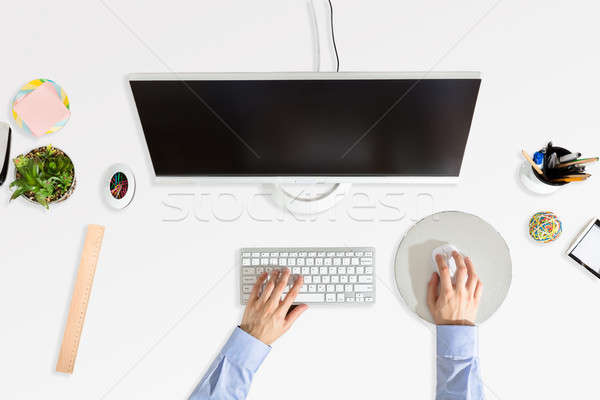 Stock photo: Businessperson's Hand Working On Computer