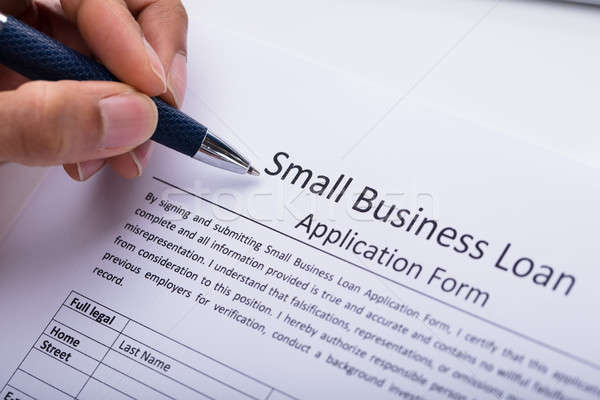 Empresário enchimento empresa de pequeno porte empréstimo aplicação forma Foto stock © AndreyPopov