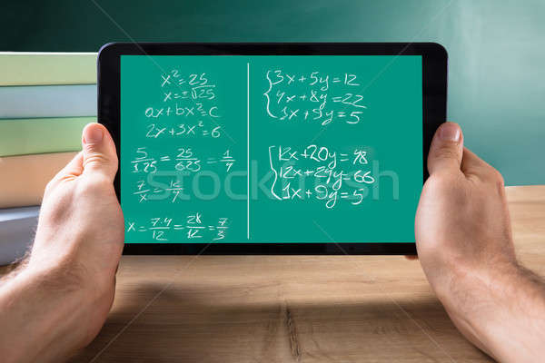 Person Holding Tablet With Mathematical Equations On Screen Stock photo © AndreyPopov