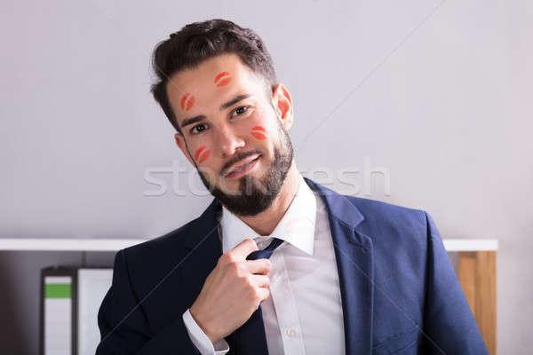 Imprenditore rossetto bacio faccia primo piano giovani Foto d'archivio © AndreyPopov