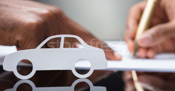 Person's Hand Signing Car Loan Agreement Contract Stock photo © AndreyPopov