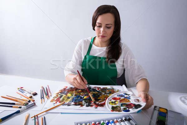 Sanatçı boya paletine boyama tuval Stok fotoğraf © AndreyPopov