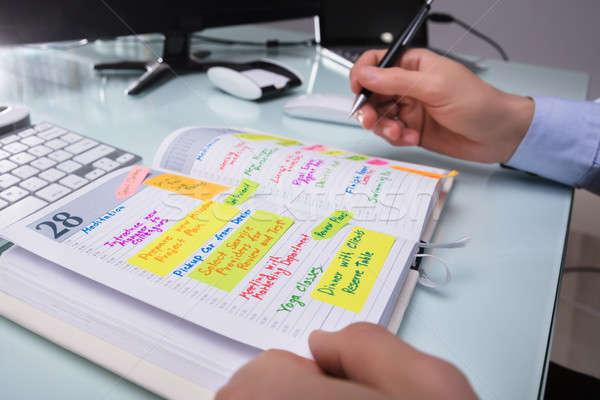 üzletember ír menetrend napló kéz toll Stock fotó © AndreyPopov