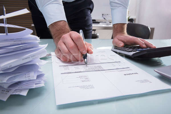 Human Hand Calculating Invoice Stock photo © AndreyPopov