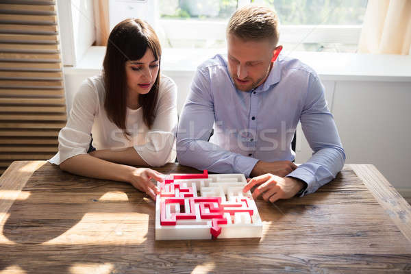 Stock photo: Two Businesspeople Solving Maze Puzzle