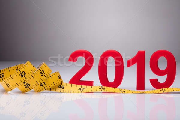Yellow Measuring Tape Near Year 2019 Stock photo © AndreyPopov