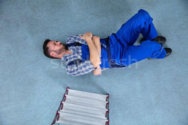 Ferido handyman piso queda mão homem Foto stock © AndreyPopov