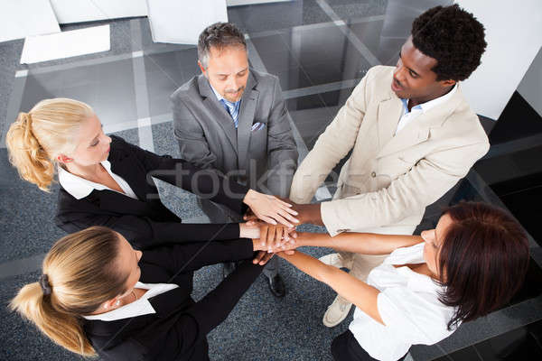 Multiracial Businesspeople Stacking Hands Stock photo © AndreyPopov