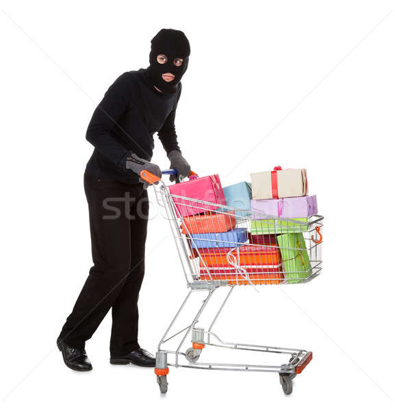 Thief pushing a trolley of gifts Stock photo © AndreyPopov