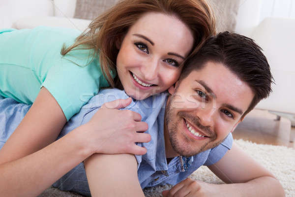 Stock photo: Happy Young Couple Lying On Front