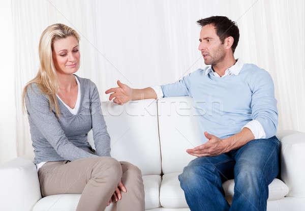 Casal fora desacordo sessão sofá família Foto stock © AndreyPopov