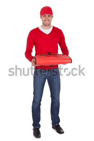 Portrait of pizza delivery boy with thermal bag Stock photo © AndreyPopov