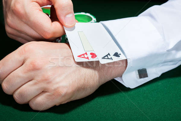 Human hand with playing cards in sleeve Stock photo © AndreyPopov