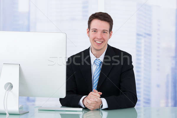 Businessman Using Computer At Office Desk Stock photo © AndreyPopov