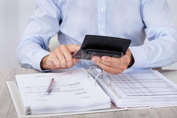 Businessman Calculating Financial Expenses Stock photo © AndreyPopov