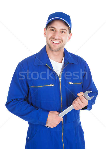 Mechanic In Blue Overalls Holding Spanner Stock photo © AndreyPopov