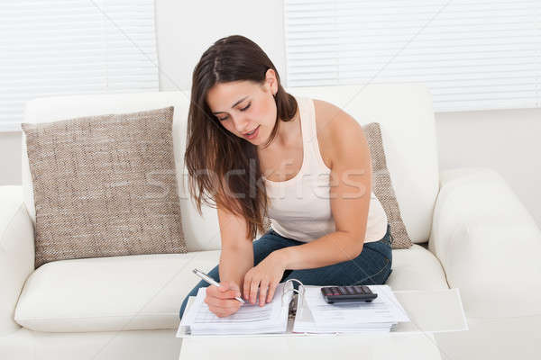 Confident Woman Calculating Home Finances At Table Stock photo © AndreyPopov