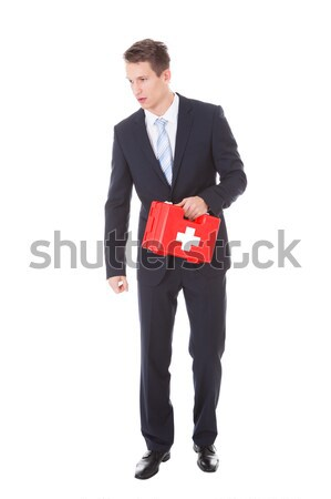 Businessman Holding First Aid Box Stock photo © AndreyPopov