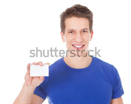 Young Healthy Athletic Man Holding Blank Visiting Card Stock photo © AndreyPopov