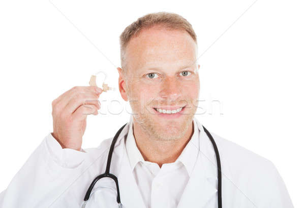 Doctor Holding Hearing Aid Device Stock photo © AndreyPopov