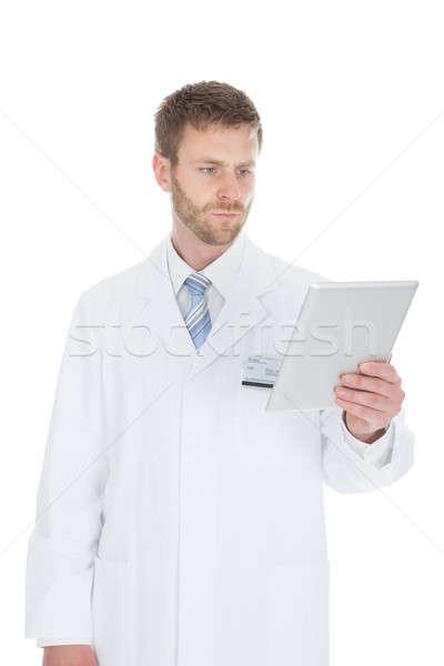 Stok fotoğraf: Gülen · erkek · doktor · dijital · tablet · genç · beyaz