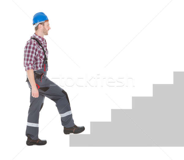 Manual trabajador caminando blanco vista lateral Foto stock © AndreyPopov