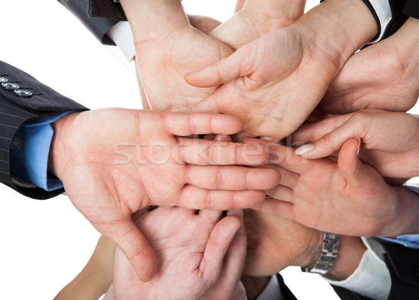 Business people stacking hands Stock photo © AndreyPopov