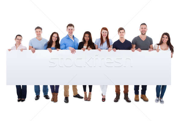 Diverse group of people presenting banner Stock photo © AndreyPopov