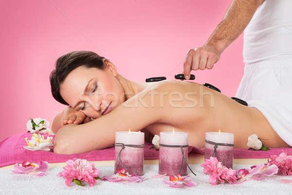 Kobieta hot kamień terapii spa portret Zdjęcia stock © AndreyPopov