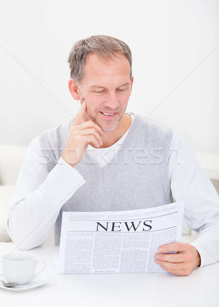Mature Man Reading Newspaper Stock photo © AndreyPopov