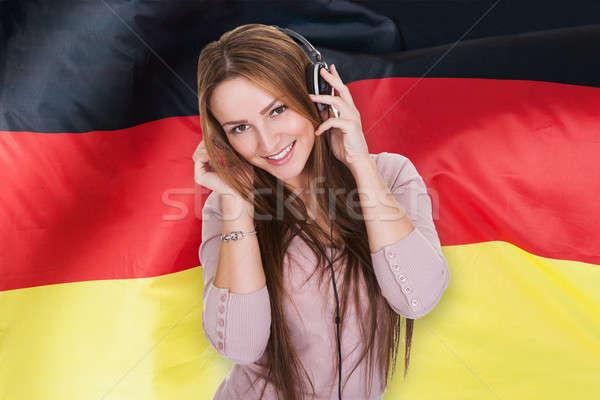 Woman Listening German Learning Audiobook Stock photo © AndreyPopov