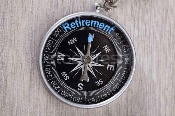Stock photo: Compass On Table Indicating Retirement Word