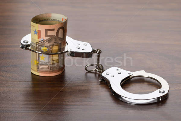 Euro Notes With Handcuffs Stock photo © AndreyPopov