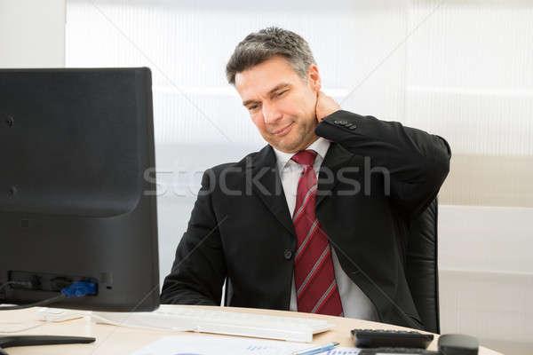ストックフォト: ビジネスマン · 首の痛み · 成熟した · 作業 · オフィス