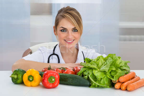 Female Dietician With Vegetables Stock photo © AndreyPopov