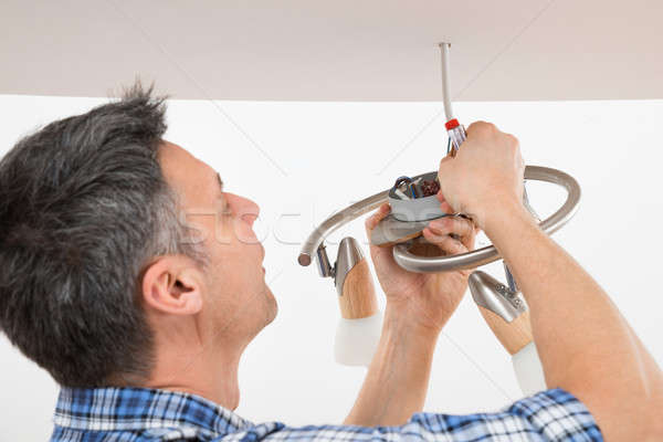 Electrician Fixing Light On Ceiling Stock photo © AndreyPopov