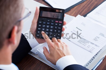 Businessperson Hands Calculating Expenses At Desk Stock photo © AndreyPopov