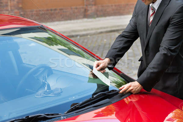 Man Holding A Parking Ticket Stock photo © AndreyPopov