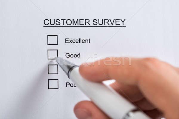 Person Hands Filling Customer Survey Form Stock photo © AndreyPopov
